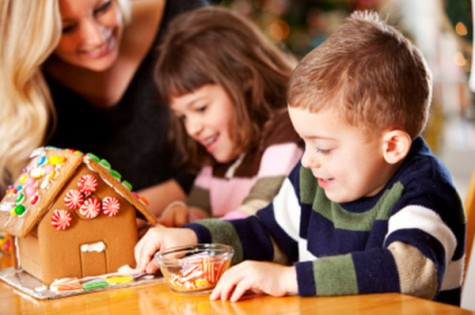 Kids decorating gingerbread house