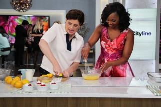 Host Tracy Moore and food personality Claire Tansey cook in the kitchen.