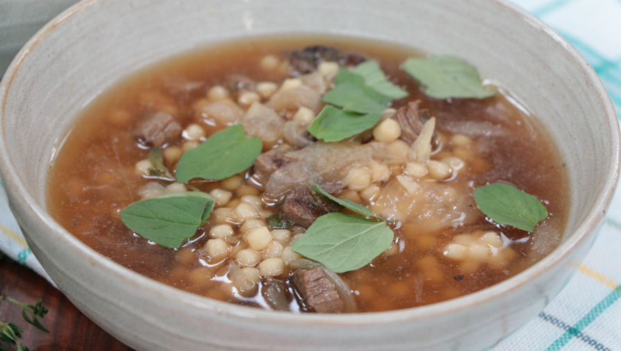 Wholesome lamb, caramelized onions and couscous soup