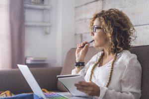 Women brainstorming in front of computer