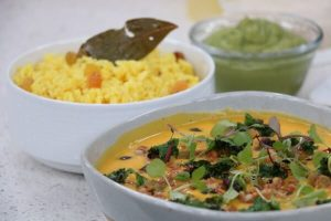Sweet potato curry with charred kale and avocado on pilau rice