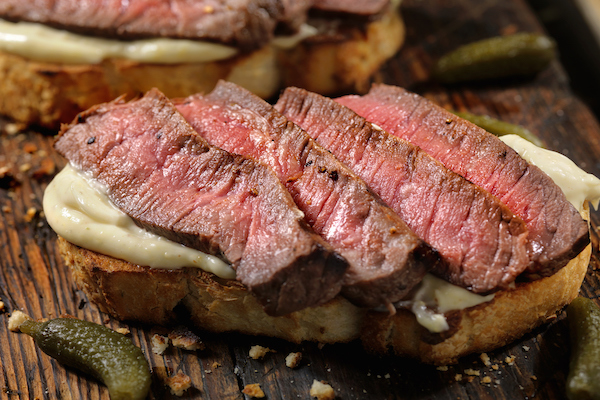 Steak sandwich with grilled onions and horseradish mayo - Cityline